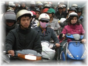 Hanoi motor scooters are primarily 2 stroke engines inefficient transportation
