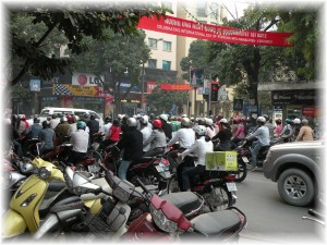 Motor Scooters at an Intersection in Hanoi